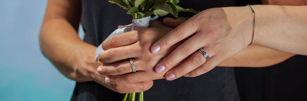 CAD Fantastic jewellery - Mrs and Mrs wedding bands holding flowers